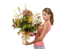 Look at my flowers!. Expressive blond model in studio holding fresh bouquet of floers Royalty Free Stock Image
