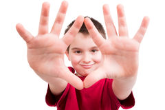 Look my Hands are Clean. Young boy showing his hands and looking at you between them with confident, all ten fingers are visible Royalty Free Stock Image