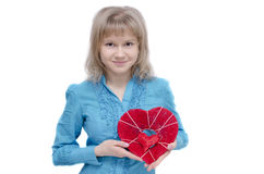 Look at my heart. A young woman is holding a heart in her arms Stock Photo