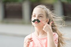 Look at my mustache. Kid long hair happy smile face. Summer holidays. Fun and humor. Girl carefree child having fun. Nice day to have fun with photo booth stock photo