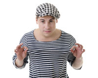 Look naughty rowdy stylish young man. Look naughty rowdy handsome young man in stylish striped dress and cap Stock Photo