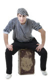 Look naughty and rowdy stylish young man. Look naughty handsome young man in stylish striped dress and cap with suitcase Royalty Free Stock Photography