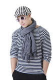 Look naughty and rowdy stylish young man. Look naughty handsome young man in stylish striped dress, glasses and cap Stock Photo
