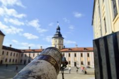 A look from an old ancient spyglass on a European medieval tourist building, a castle, a palace with a spire and a tower royalty free stock photo