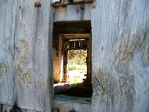 Look through the old door royalty free stock photography