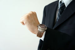 Look at one's wrist for a watch Royalty Free Stock Photography