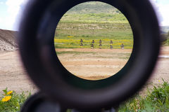 A look through an optical sight aimed at a group of potential targets at the range Royalty Free Stock Images