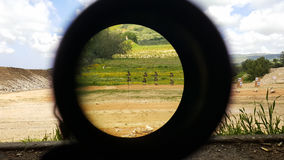 A look through an optical sight aimed at a group of potential targets at the range Stock Photo