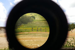 A look through an optical sight aimed at a group of potential targets at the range. Outdoor shot, Israeli army IDF training zone Royalty Free Stock Images