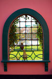 Look through oriental window. With steel grid Royalty Free Stock Photography