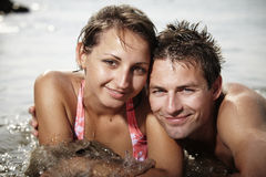 Look at our love. Young couple relaxing at beach in Italian resort Caorle bathing in sea water and summer sun royalty free stock images