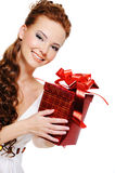 Look out beautiful smiling woman with red box Stock Photo