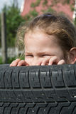 Look out. Naughty girl watch out of the tires Stock Images