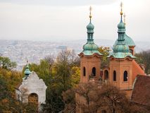 Look out from Petrin onto St Lawrence Church in Prague royalty free stock images