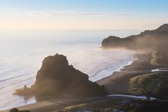 Look Out to Lion Rock Piha Beach Auckland New Zealand Aerial view of Piha Beach near Auckland. Most popular beach for surfing. Beautiful summer scenery stock images