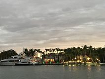 A look over the bay at yachts and mansions in Miami Beach, Florida. Miami is an international city at Florida`s southeastern tip. Its Cuban influence is Stock Image