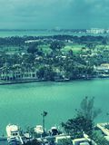 A look over the bay of yachts and mansions in Miami Beach, Florida. Miami is an international city at Florida`s southeastern tip. Its Cuban influence is Stock Image
