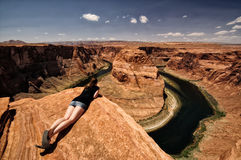 Look over the Edge. Woman looking over the edge of the abyss at the Grand Canyon, Arizona, USA Royalty Free Stock Photos