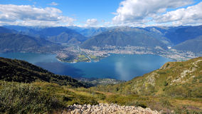 A look over the Lake Locarno. (Ticino, Switzerland) on a summer day. The cities of Ascona and Locarno are lying next to the lake Stock Images