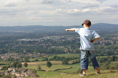 Look over there !!. A boy pointing towards a view royalty free stock images