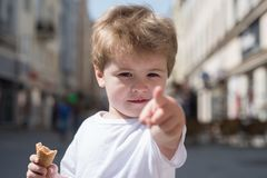 Look over there. Little child point finger on city street. Small boy with stylish haircut. Little child with short blond. Hair. Healthy hair care habits. Hair royalty free stock photos