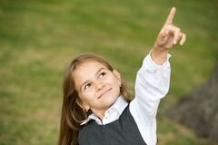 Free Look Over There. Little Child Point Finger Up Outdoors. Little Girl Wear School Uniform. Back To School. Kids Education Stock Photography - 193059702