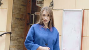 Look of passionate woman walks, turns and smiles on the street. Slowly stock video footage