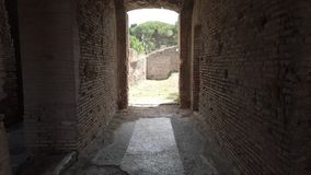 A look at the past while walking in the Roman ruins in Ostia Antica - Rome. A look at the past while walking in the Roman ruins in Ancient Ostia with beautiful stock footage