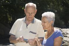 Look at that picture!. Senior couple looking at the pictures they have taken with a digital camera Stock Photo