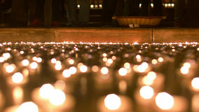 Look at the Podium in the Church. Candles lit by people burning in front of the church podium Stock Images