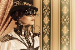 Look through. Portrait of a beautiful steampunk woman over vintage background Royalty Free Stock Images