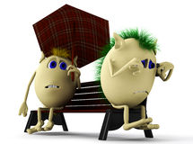 Look on puppets sitting on brown bench Royalty Free Stock Photos