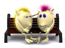 Look on puppets sitting on brown bench Royalty Free Stock Photo