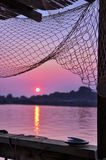 Sunset and fishing net. Look from restaurant on sunset,beautiful view on the sea Royalty Free Stock Photography
