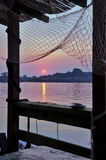 Sunset and fishing net. Look from restaurant on water,beautiful view on sunset Royalty Free Stock Photo