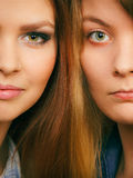 Comparison of girls with and without make up. Look results of using cosmetics. Portrait of two girls one with and second without make up. Comparison of natural Stock Image