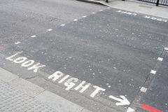 Look right. Road markings at a pedestrian crossing Stock Images