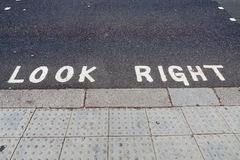 Look right notice on the road Stock Photography
