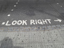 Look Right. `Look Right` pavement warning on a street in London, UK Stock Images