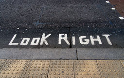 Look right road paint, sign, warning Stock Photography