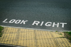 Look right sign painted on the road asphalt Royalty Free Stock Photography