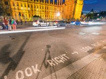 Look right street sign in front of Big Ben at night, London.  Stock Photo