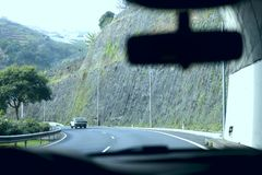 A look at the road of the island of Madeira from the window of the car when leaving the tunnel. royalty free stock photo