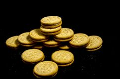 Look it`s A big stack of sweet round cookie`s. A cookie is a baked or cooked food that is small, flat and sweet. It usually contains flour, sugar and some type Royalty Free Stock Image