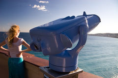 Look at the sea. Telescope closeup and beautiful girl on background stock photography