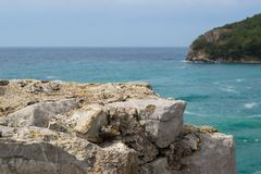 A look at the sea from the mountain. Stone in the foreground. The sea is unfocused. Adriatic.  Royalty Free Stock Photo