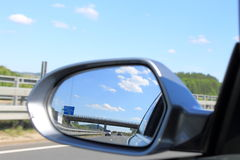Look in the side mirror on the car Royalty Free Stock Photography