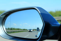 Look in the side mirror on the car Stock Photos