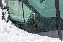 Look through the side window of a snow covered truck Stock Image