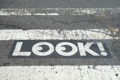 Look!. A Look! sign on a New York street, to encourage pedestrians to watch where they are going and prevent accidents stock image